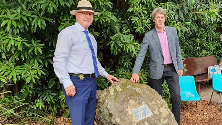 Mayor Jamieson and Councillor Law beside the rock which bears the dedication plaque.